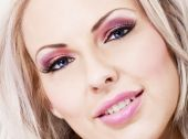 Beautiful Blonde Woman With Pink Makeup And Lips
