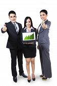 Business People Showing Graph On Laptop