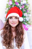 Closeup portrait of sweet teen girl on Christmas tree background, New Year childrens party, happy wintertime holidays concept