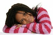 picture of cornrow  - closeup portrait of a young black child with head on arms - JPG