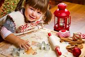 Little Girl Baking Christmas Cookies Cutting Pastry With A Cookie Cutter