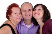 Happy Man With His Mother And Sister Together Trio Portrait