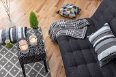 pic of futon  - Detail of a bright modern living room with gray sofa - JPG