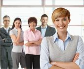 picture of work crew  - Portrait of businesswoman and team of happy businesspeople - JPG