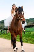 Girl Riding Brown Horse.