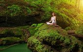 stock photo of padmasana  - Relaxation in forest at the Waterfall - JPG
