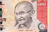 image of gandhi  - The portrait of Gandhi on a one - JPG