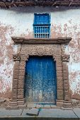 ancient door in the peruvian Andes at Moray in Cuzco Peru