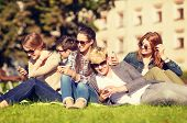 education, technology, internet, summer holidays, social networking and teenage concept - group of t