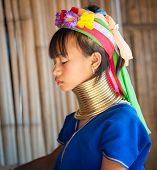 MAE HONG SON, CHIANG MAI, THAILAND - DEC 4, 2013: Unidentified Karen Long Neck girl in traditional hill tribe village also known as Kayan indigenous  ethnic group. Famous tourist travel destination.