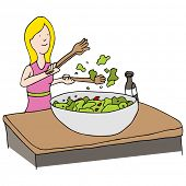 An image of a woman making a tossed salad.