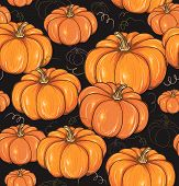 Black seamless background with pumpkins