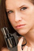 Pretty Woman Angry Looking Female Holds Pistol Revolver Handgun Weapon