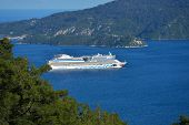MARMARIS, TURKEY - APRIL 17, 2014: Cruise ship AIDAdiva exit from the bay of Marmaris. AIDA ships ca