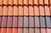 foto of red roof tile  - Colorful roof tiles in sunny day closeup - JPG