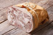 Headcheese Closeup On Table Tied With Twine And Wrapped In Paper