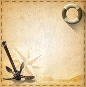 stock photo of rusty-spotted  - Old yellowed paper with spots compass rose lifebuoy sailing ship and old rusty anchor concept of adventurous travels - JPG
