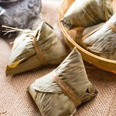 Traditional steamed sticky glutinous rice dumplings. Hot rice dumpling or zongzi. Chinese food dim s