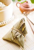 Zongzi or rice dumpling. Traditional steamed sticky glutinous rice dumplings. Chinese food dim sum.
