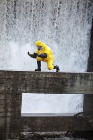 image of toxic substance  - scientist in protective uniform examining toxic substance in contaminated area - JPG