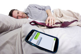 image of goodnight  - cell phone screen showing text messages while male is in bed - JPG
