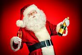 Santa Claus with a glass of champagne wishes all a Merry Christmas. Over festive red background.