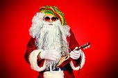 Casual Santa Claus hippie playing ukulele over festive red background.