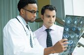 stock photo of mri  - Closeup portrait of intellectual healthcare professionals with white labcoat looking at full body x - JPG