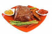 beef chunk on red dish with seasoning