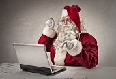 Santa typing on pc