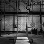 Gym nobody with barbells kettlebells bars and weightlifting gear