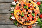 Delicious pizza served on wooden table