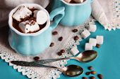 Cups of coffee with marshmallows and sugar on wooden table
