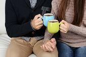 Loving couple with hot drinks