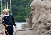 Sandsculpture artist working on his sculpture