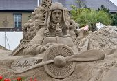 Sandsculpture of Charles Lindbergh in his airplane