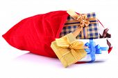 Red bag with Christmas toys and gifts isolated on white