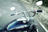 Motorcycle detail with gasoline tank and speedometer. Chrome motorcycle details close-up
