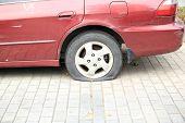 flat tire on car wheel
