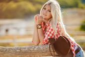 stock photo of cowboys  - Young woman portrait of a cowboy in the open air - JPG