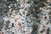 Background Made Of A Closeup Of A Wall With Pebbles