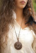 Beautiful hippie girl with medallion