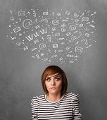 Pretty young woman gesturing with sketched social network icons above her head