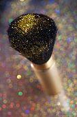Close-up on brush and gold shining powder