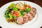 Veal meat with fresh vegetable salad