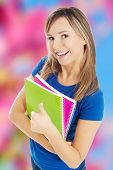 Young beautiful woman holding notebooks