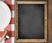 Menu chalkboard top view on table with plate, knife and fork