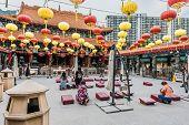 Kowloon, Hong Kong, China - May 30, 2014: people praying at Sik Sik Yuen Wong Tai Sin Temple
