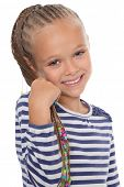 Portrait of a happy young girl with dreadlocks. The girl is six years old.