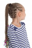 Girl showing her hair braided in dreadlocks. Girl is six years old.